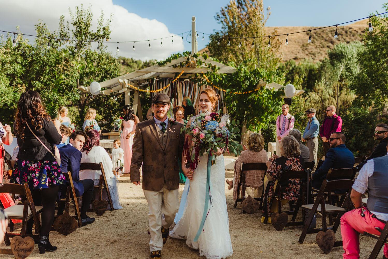 River School Farm Wedding, couple walking down their eclectic aisle