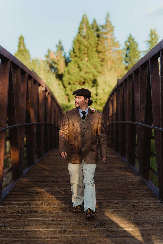 River School Farm Wedding, photo of groom walking on bridge
