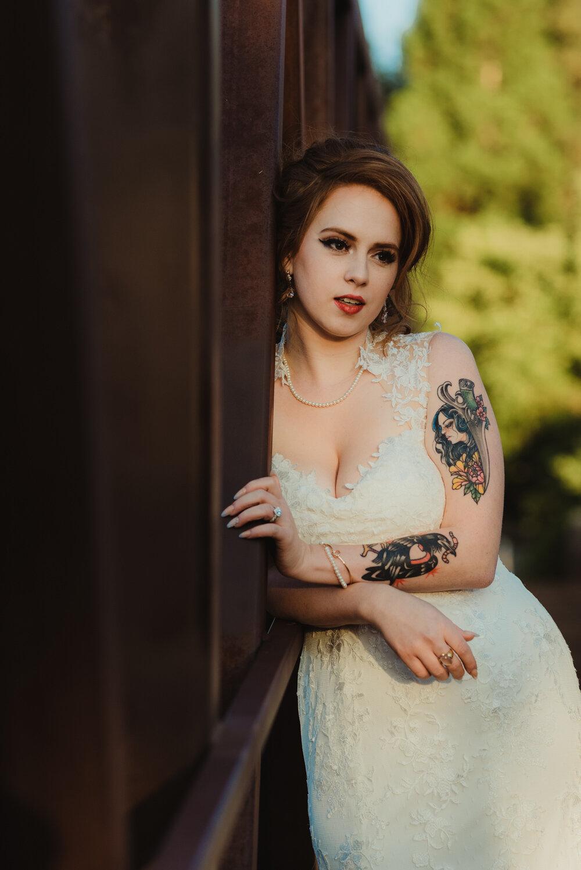 River School Farm Wedding, photo of bride leaning on a bridge