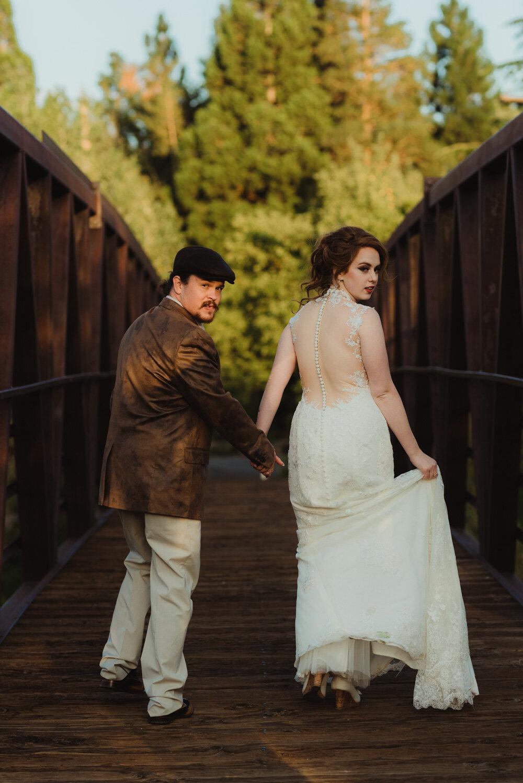 River School Farm Wedding, photo fo couple walking on a bridge