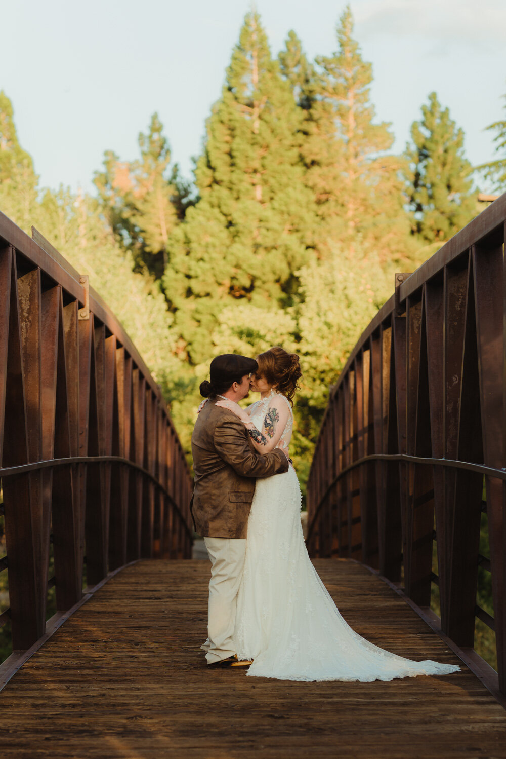 River School Farm Wedding, photo of couple standing in the middle of a bridge