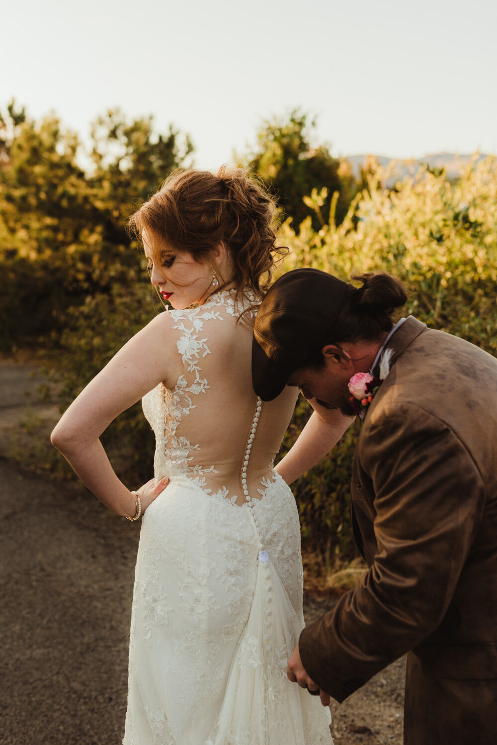 River School Farm Wedding, photo of groom helping his bride with the dress