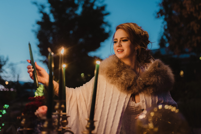 River School Farm Wedding, bride lighting up the candles photo