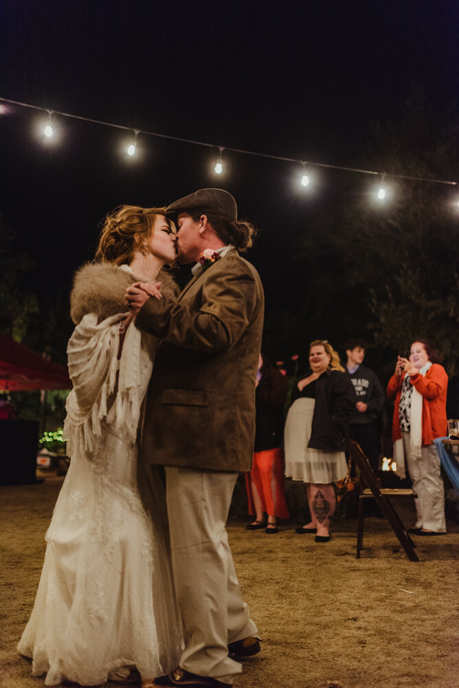 River School Farm Wedding, couples first dance under the night sky, lit up by just cafe lights