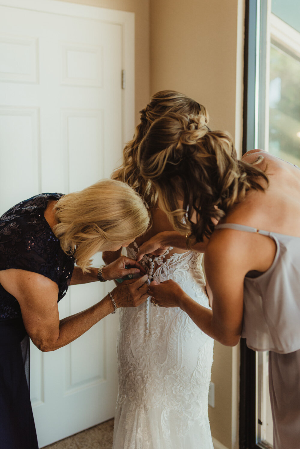 Edgewood Tahoe Wedding, bride getting her wedding dress on photo