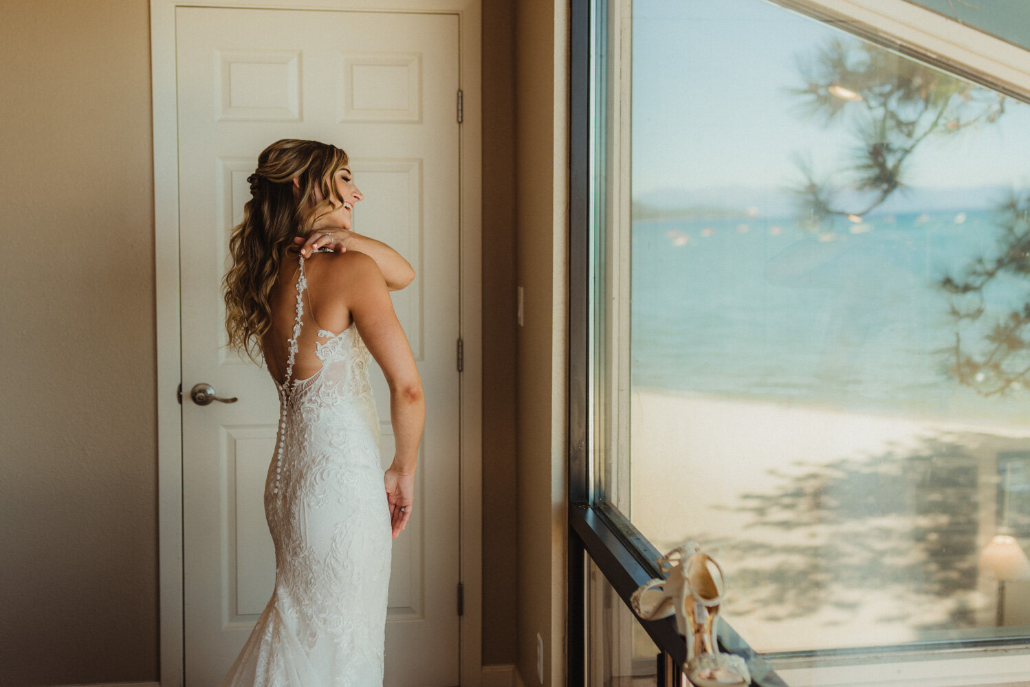 Edgewood Tahoe Wedding, photo of bride putting on her wedding dress
