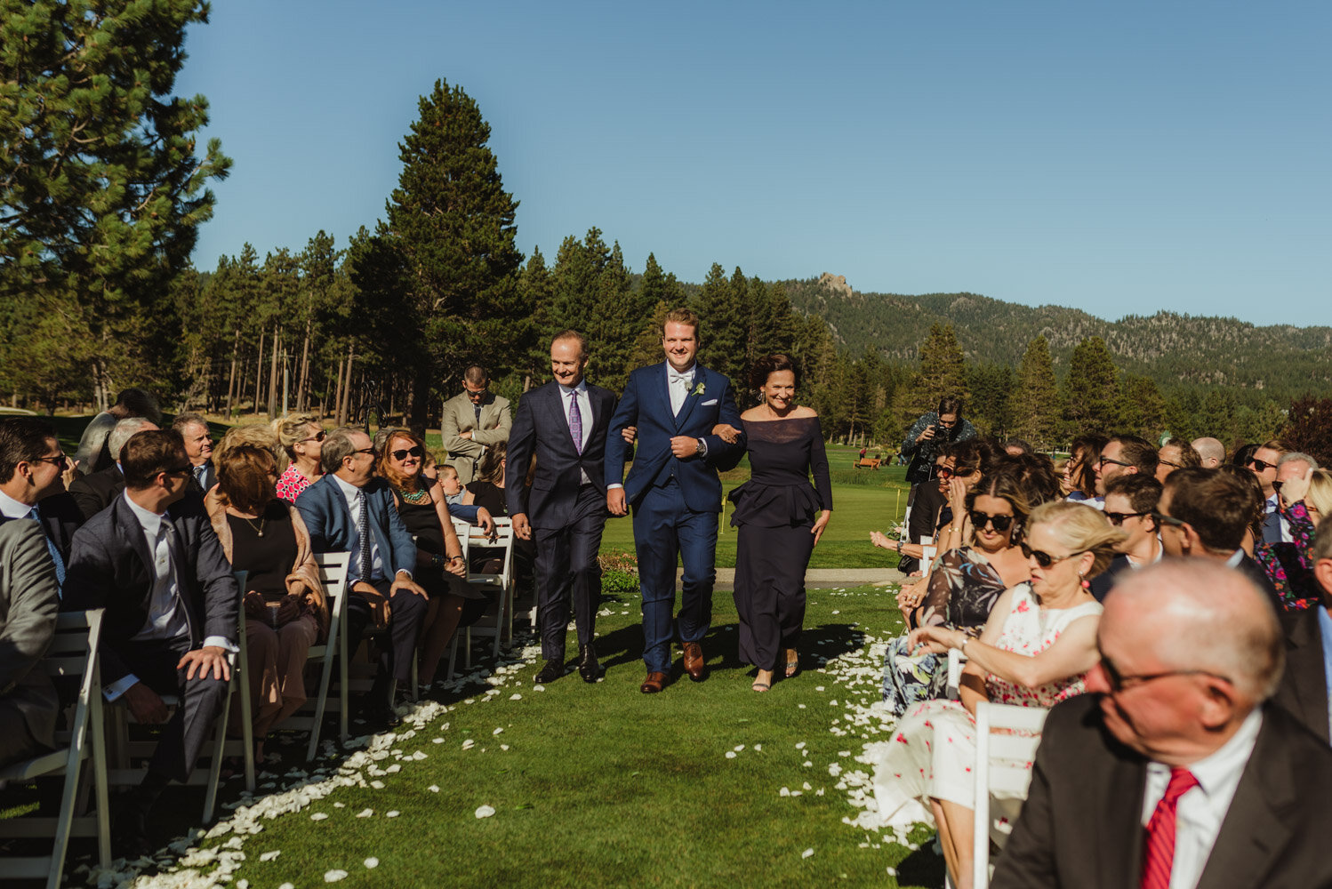 Edgewood Tahoe Wedding, groom walking down with both of his parents