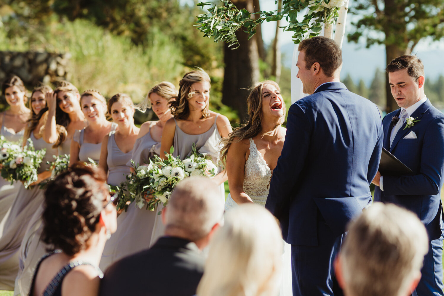 Edgewood Tahoe Wedding, bride laughing during the ceremony photo