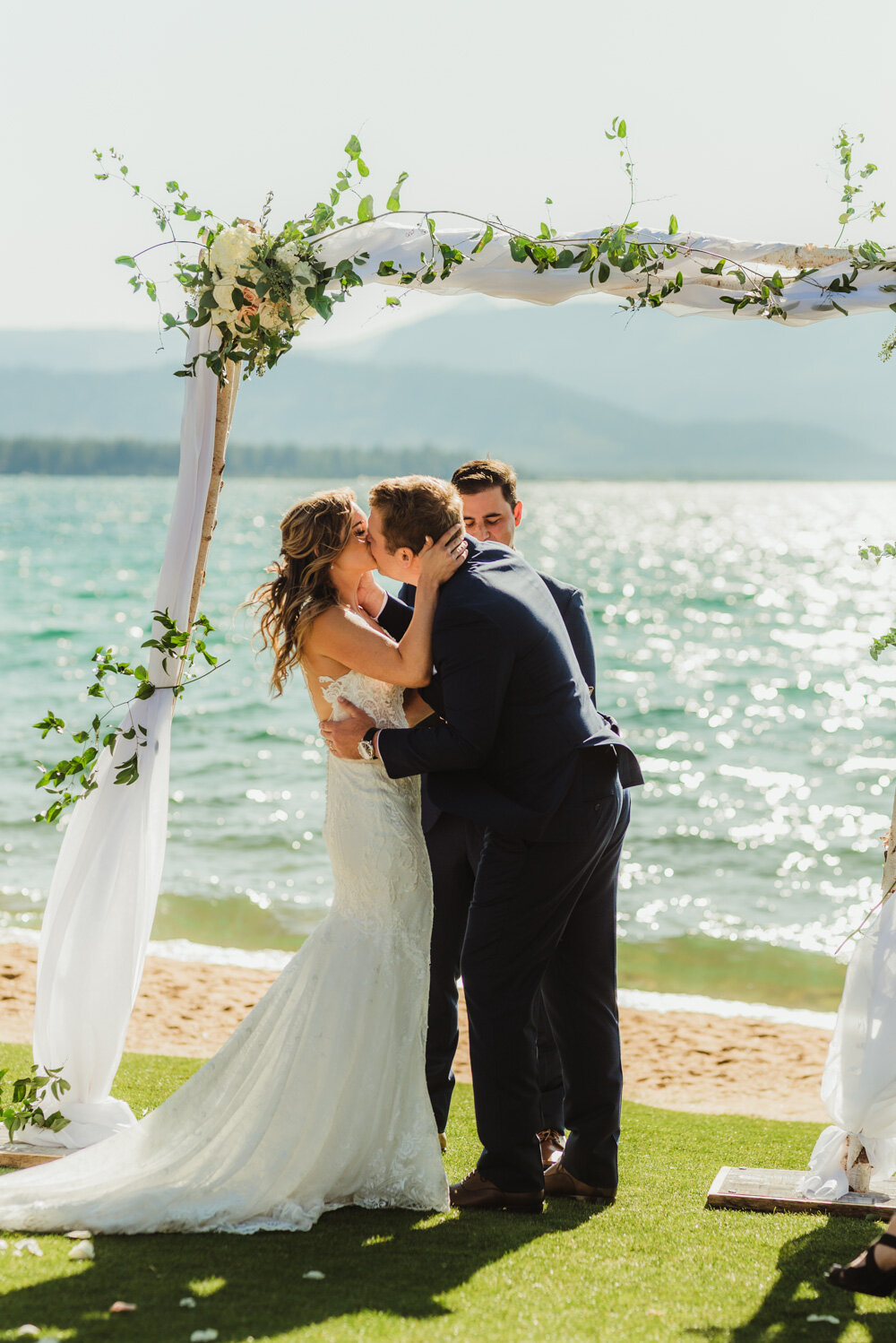 Edgewood Tahoe Wedding, photo of couple having their first kiss with Tahoe in the background