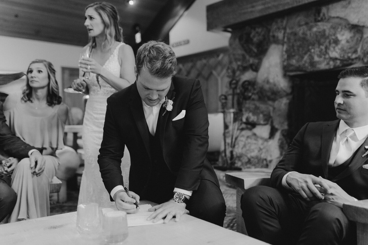Edgewood Tahoe Wedding, photo of groom signing his marriage license