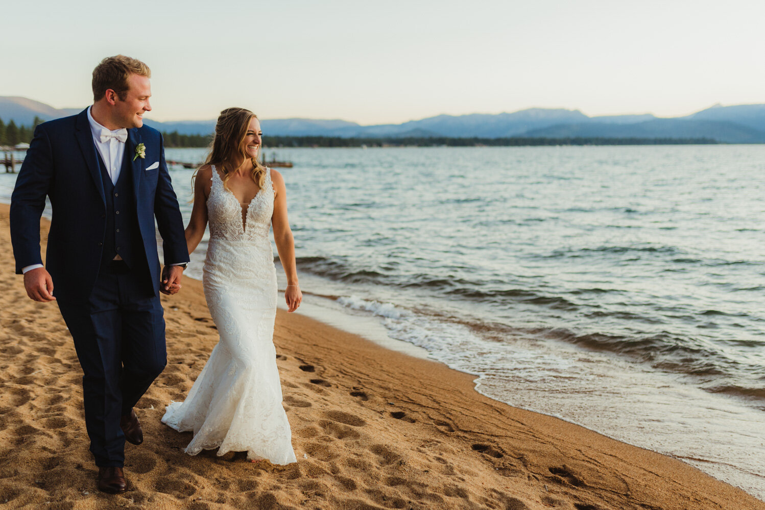Edgewood wedding, photo of couple walking by the beach photo