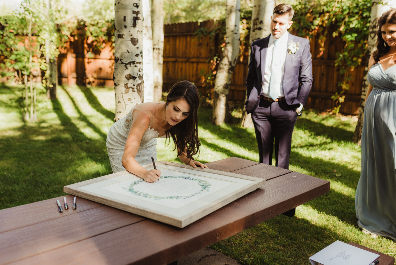 The Chateau Incline Village Wedding, jewish wedding, bride signing Ketubah