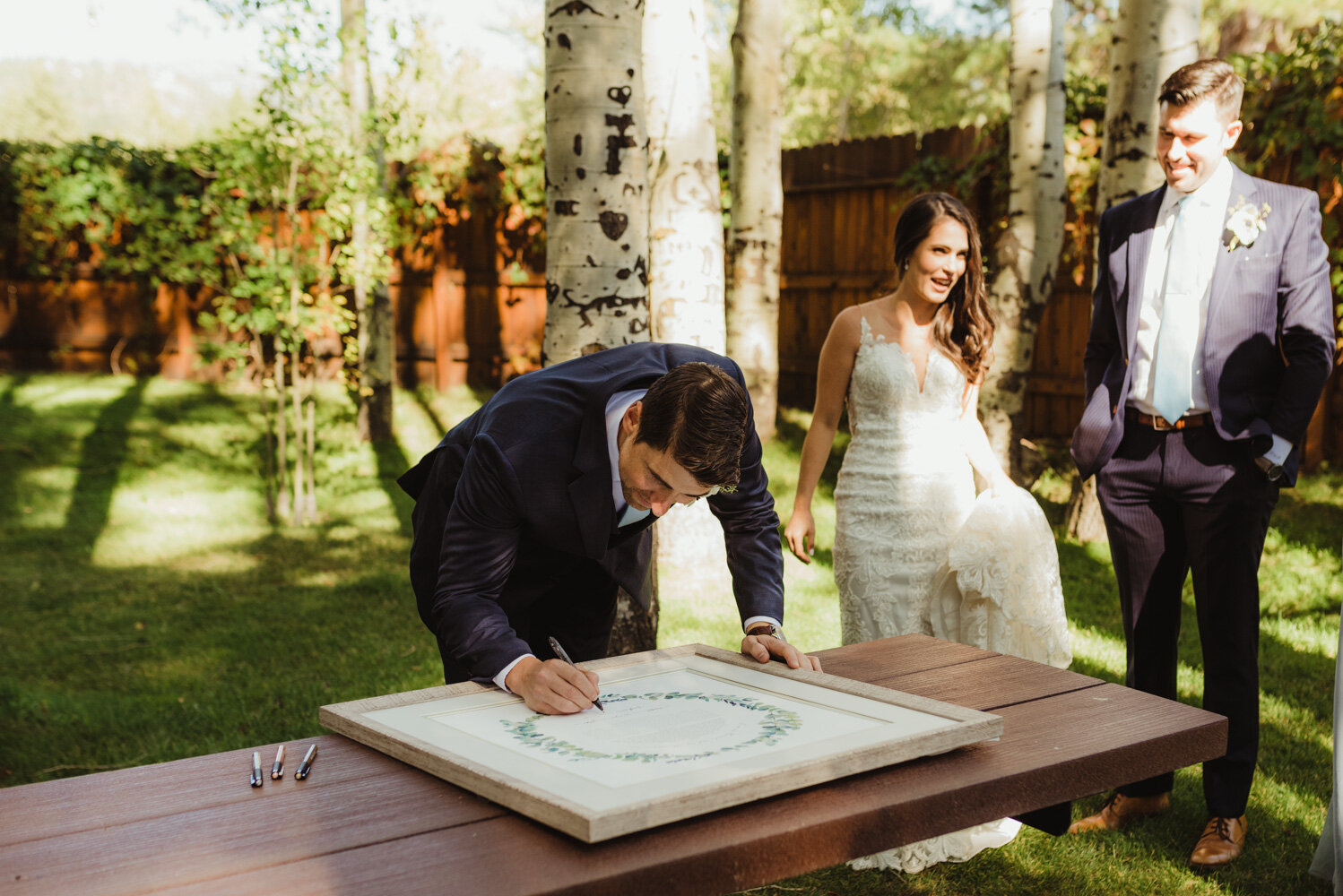 The Chateau Incline Village Wedding, photo of groom signing ketubah