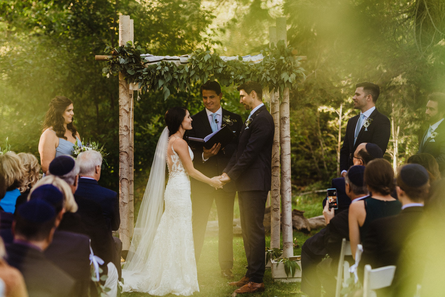 The Chateau Incline Village Wedding, couple being framed by trees photo