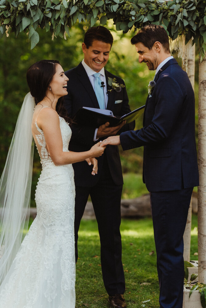The Chateau Incline Village Wedding, photo of couple under a green arch