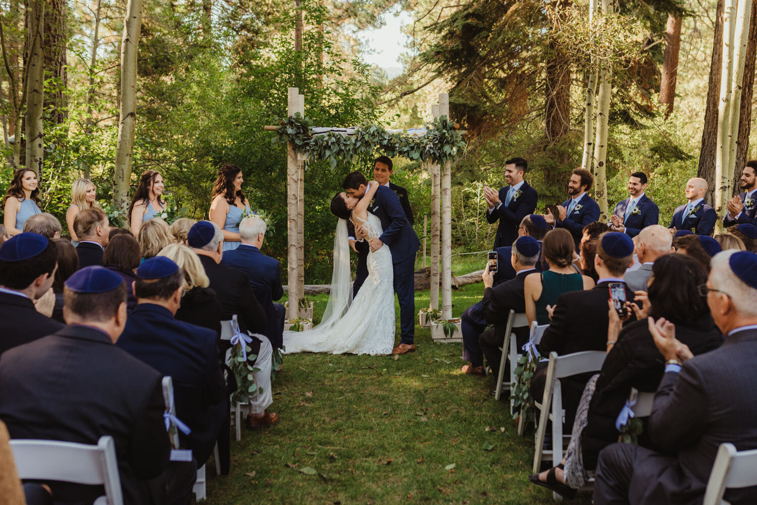 The Chateau Incline Village Wedding, photo of couples first kiss during a jewish ceremony