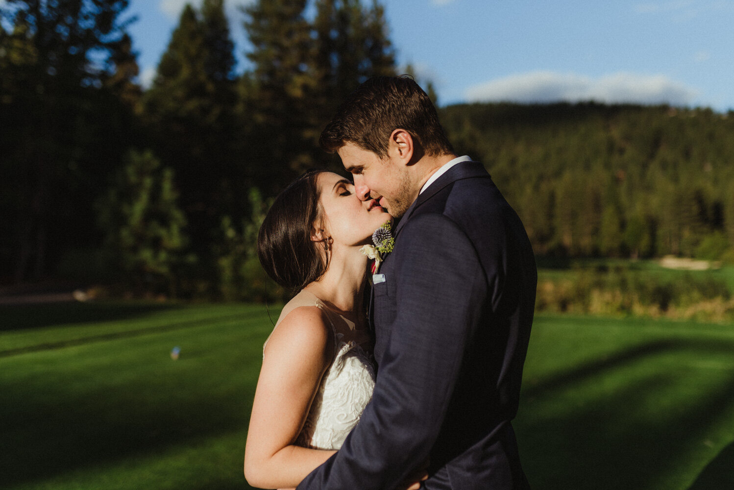 The Chateau Incline Village Wedding, jewish wedding photographer, photo of couple kissing with direct sunlight
