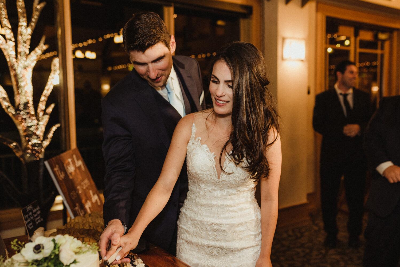 The Chateau Incline Village Wedding, jewish wedding photographer, couple cutting the cake photo