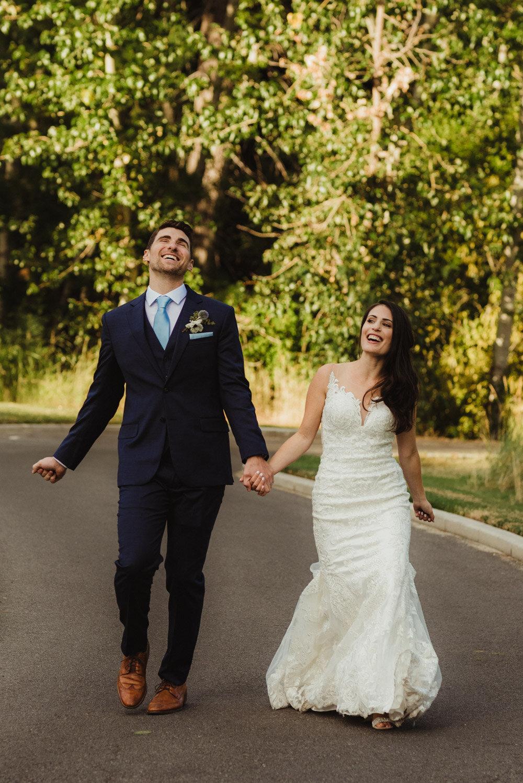 Jewish wedding photographer, couple walking on a trail photo