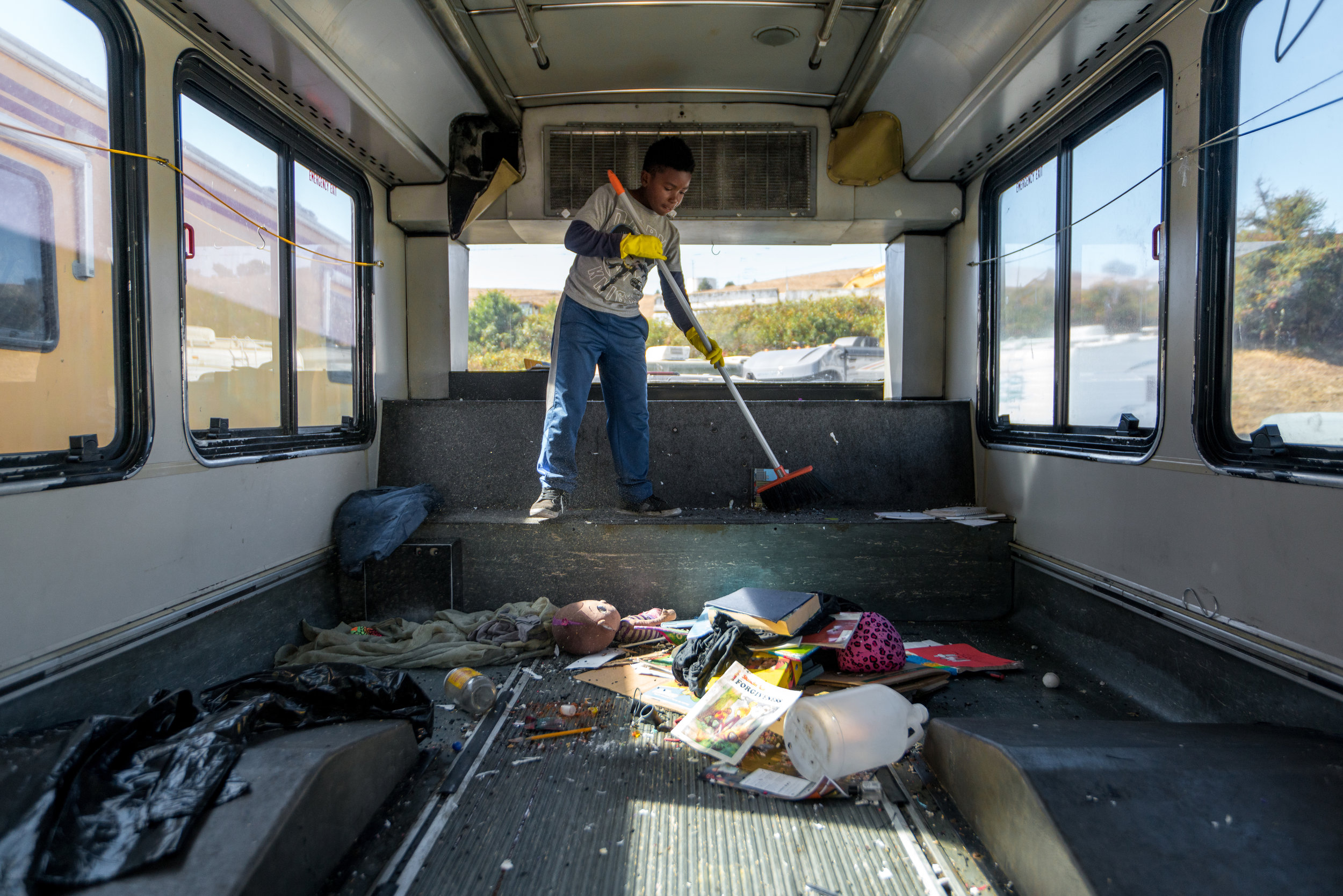 David hard at work helping us to clean out the bus!