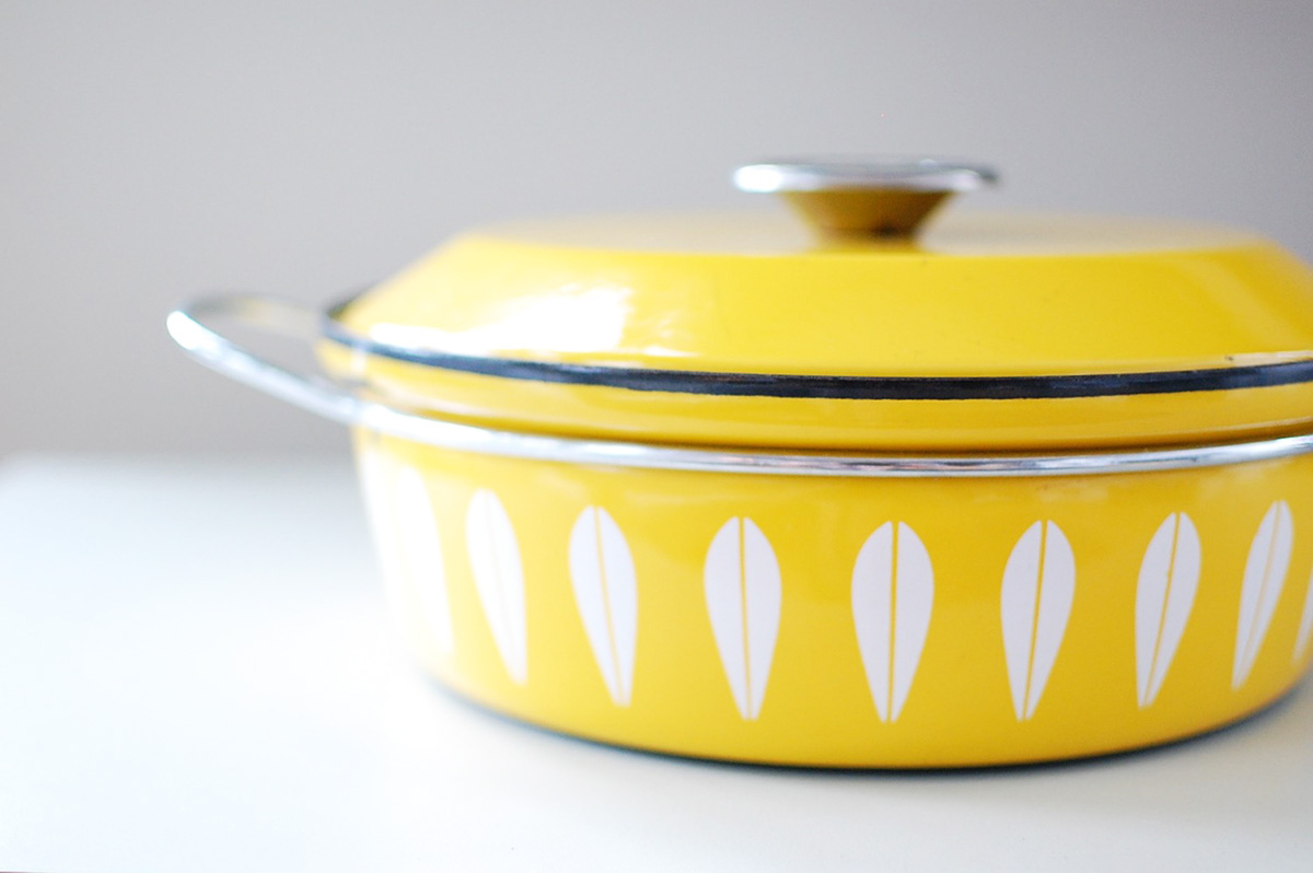 Vintage Cathrineholm kitchenware from Norway. It's all over Ebay and my stove.