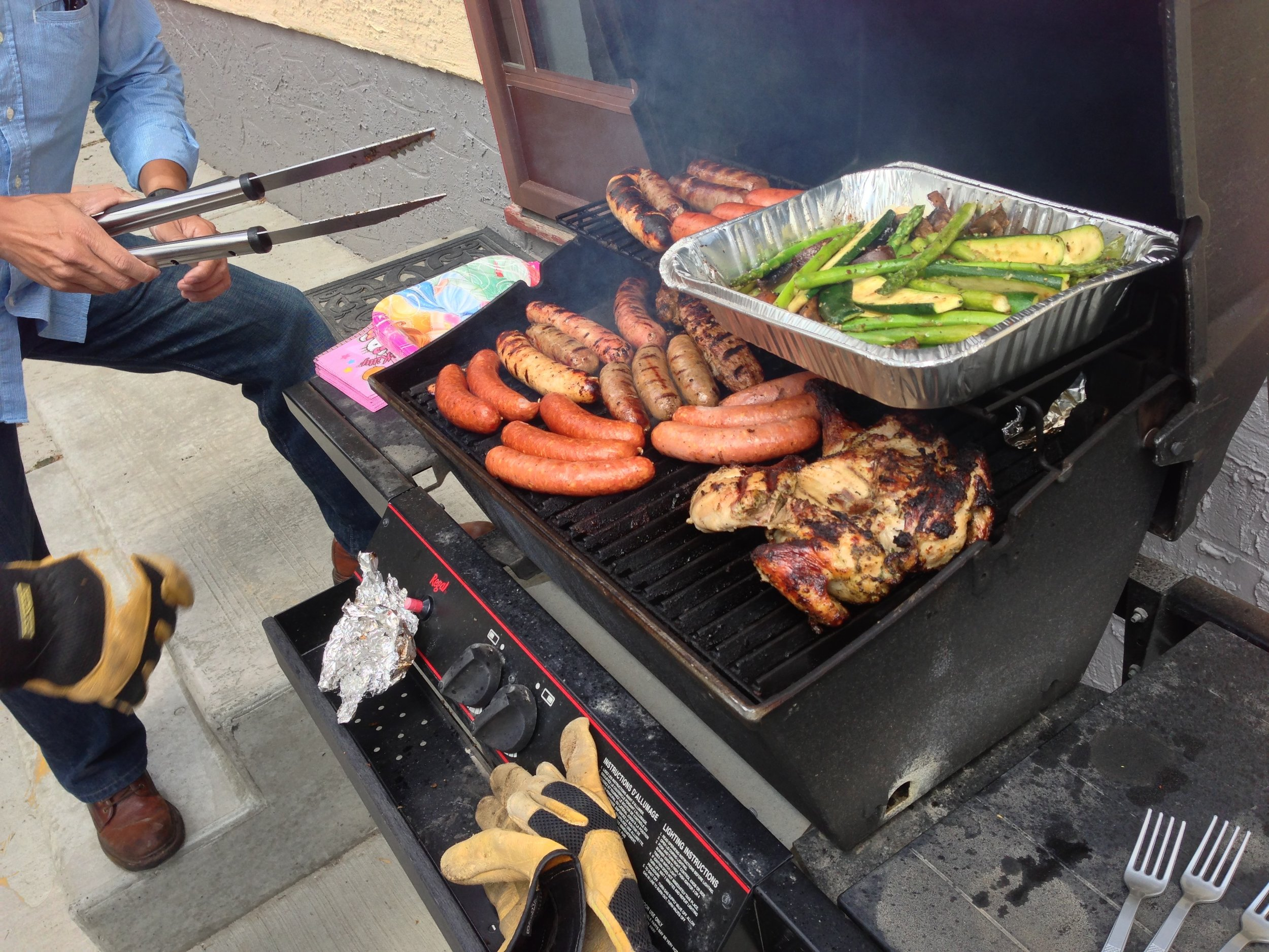 A buncha dudes and their wieners on the BBQ