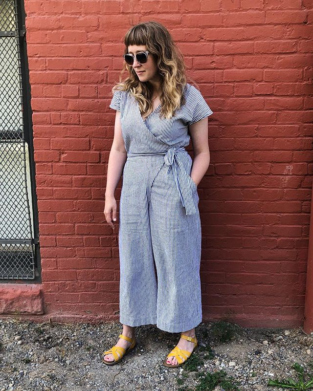 I finished my #zadiejumpsuit in July but hadn't gotten a good photo yet. It's my first jumpsuit in my wardrobe and it's been so nice to wear! Casual, but easily dressed up and really comfortable. I chose a striped Essex linen/cotton by Robert Kaufman. Lately whenever I've worn it to teach a class someone has picked the same fabric! Equally great for clothing as it is for pillows 😂. I sized down one size from my measurements and drafted a facing instead of using bias to finish the fronts. I didn't do any other fit adjustments, it's a great pattern! Quick to sew. I already have fabric for a sleeved version, and this one will be great to layer with tees in the fall and winter.  If you haven't jumped on the Zadie bandwagon you should! Pattern by @paper_theory and fabric from @drygoodsdesign
