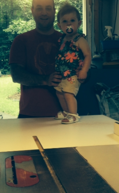 Norah, my sweet little niece, giving some best practice advice on how to use the table saw.