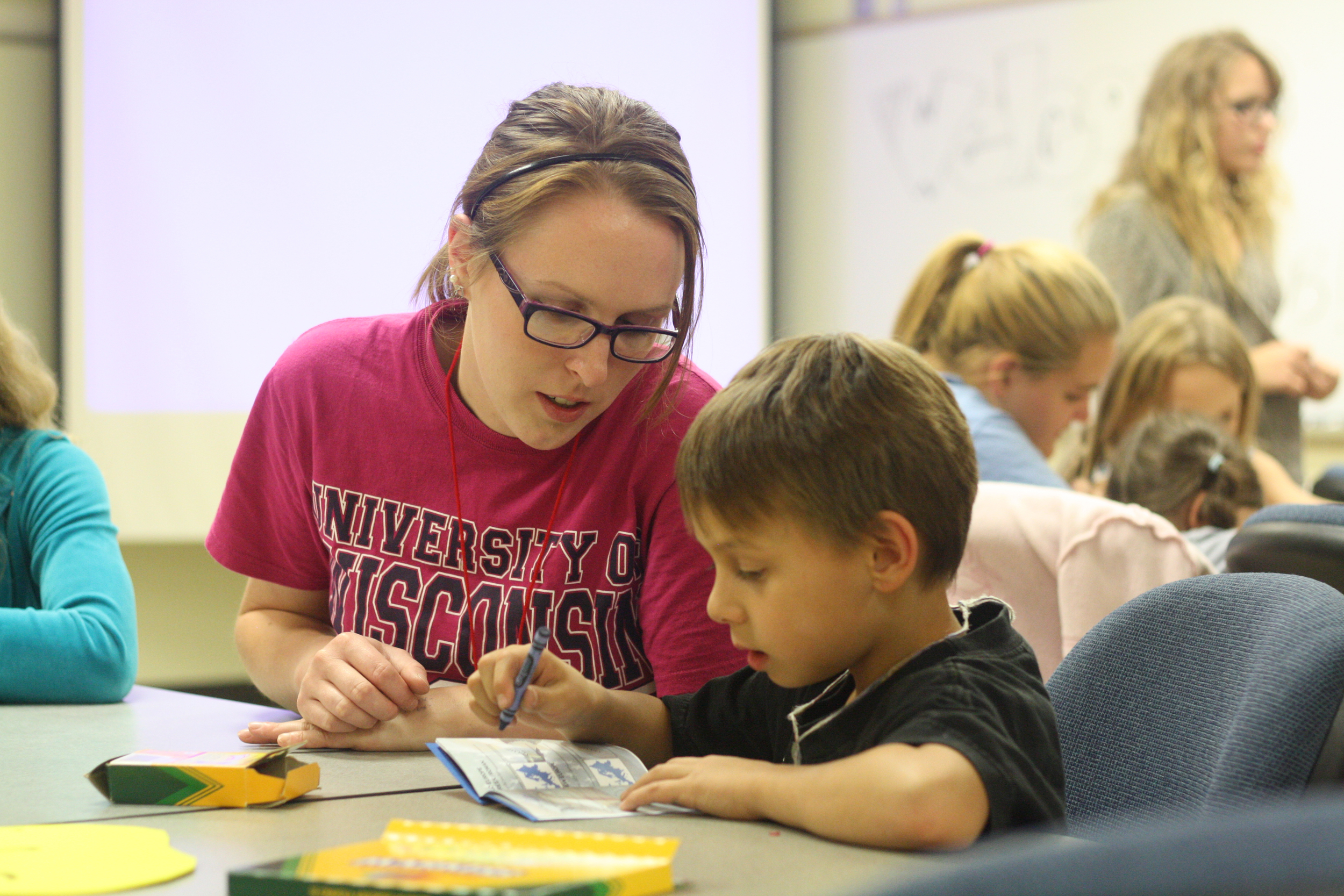 Art Education student Lucy Pronschinske gains additional teaching experience at the Children's Art Club at UW-Stout.