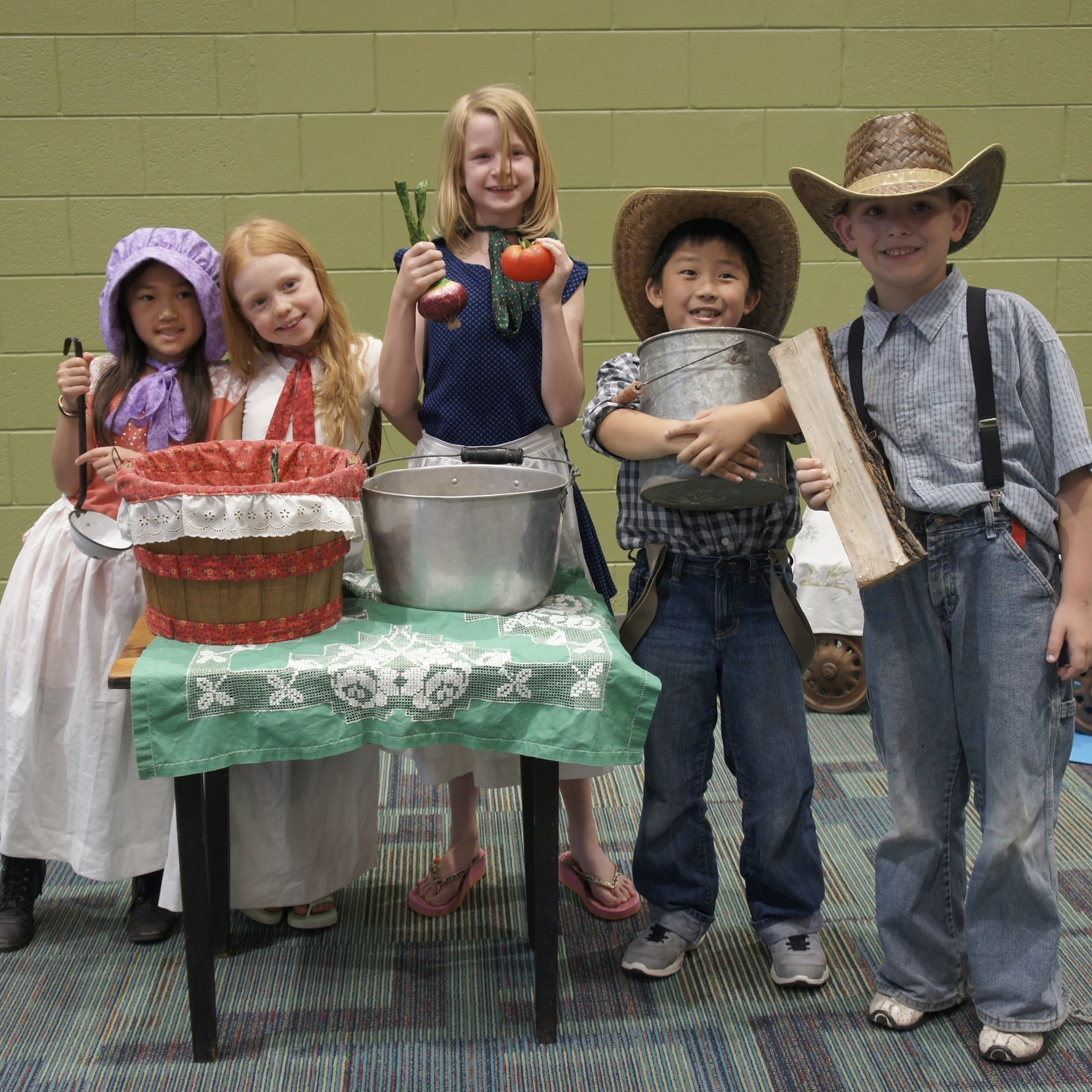 2nd graders wear costumes and act out their stories about Pioneer life.