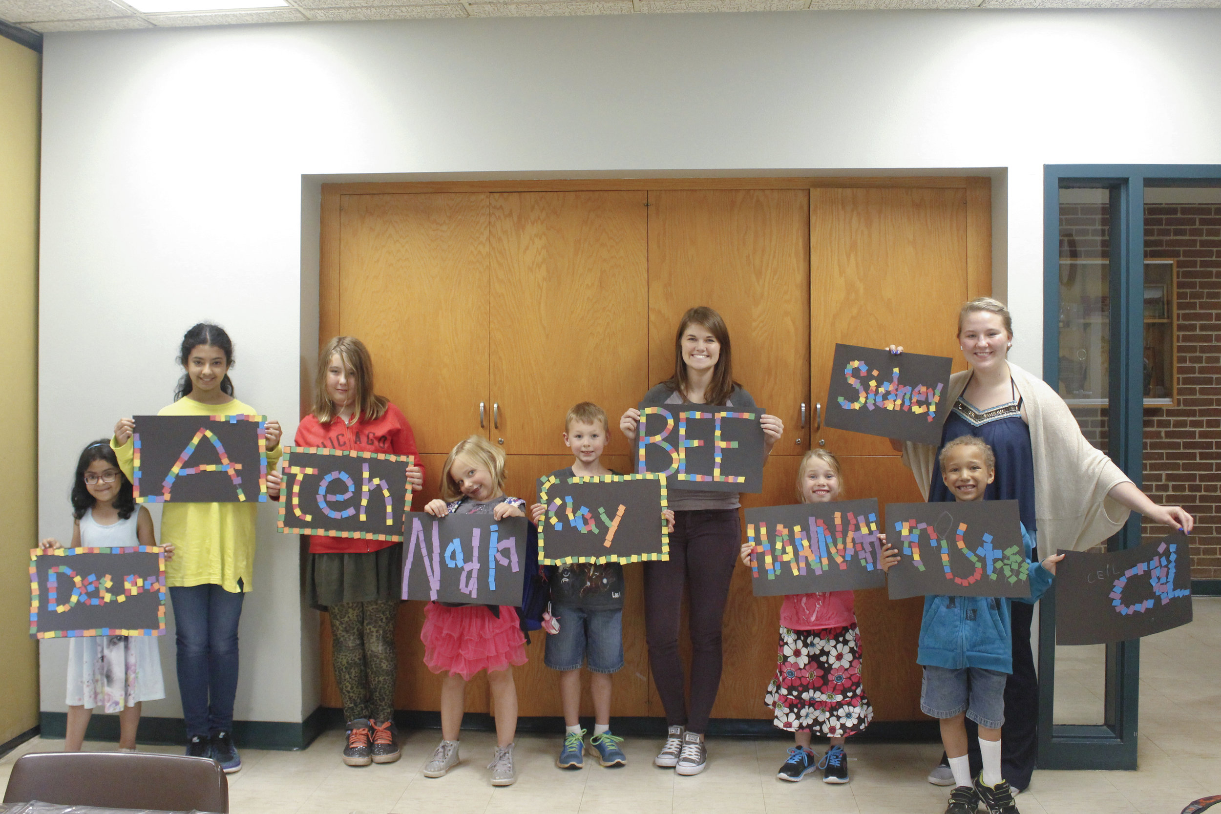 "UW-Stout interns Brittney Hanson and Sidney Dombrowski with students from their Jump Start ""Arts and Crafts"" class."