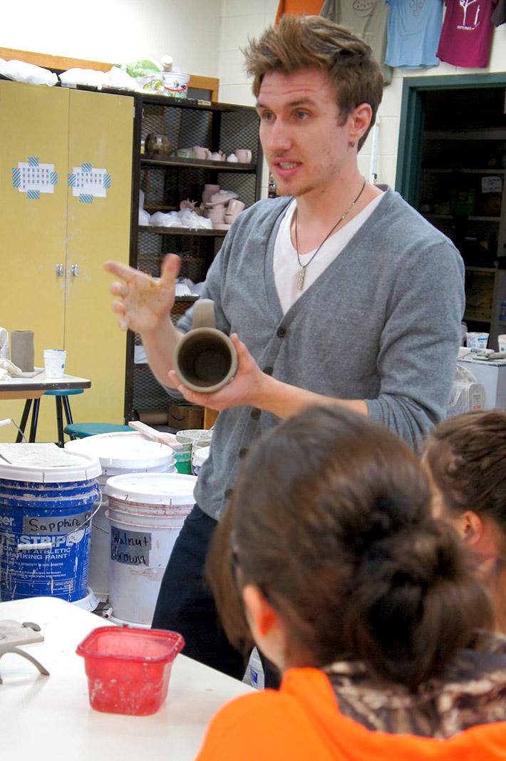 Art Education Student Teacher Dane Hodges teaches a high school ceramics class.