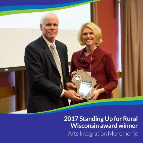 A.I.M. Executive Director, Dr. Tami Rae Weiss, and Michael Thompson ,  Deputy State Superintendent. Weiss accepts the award on behalf of UW-Stout.