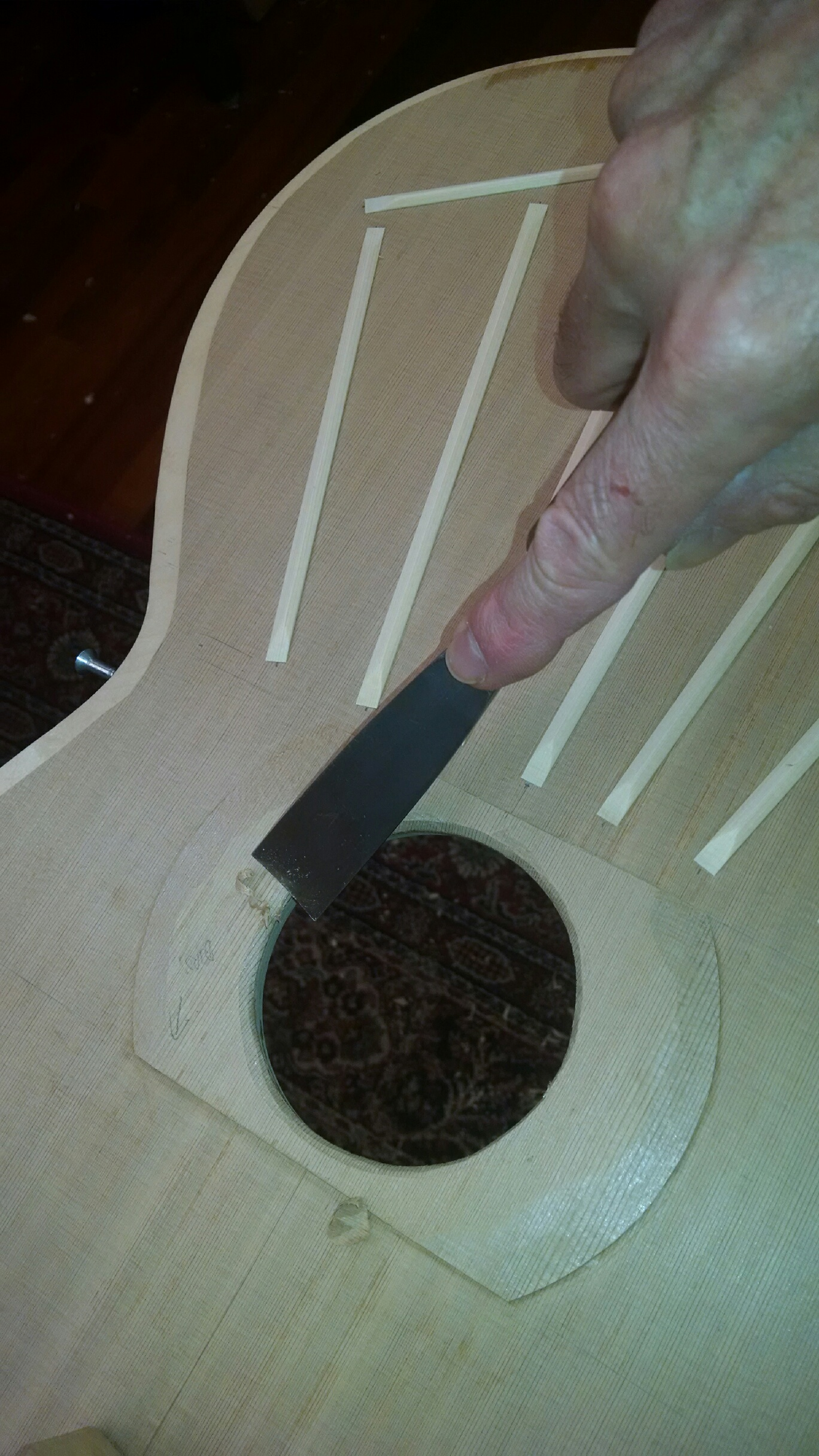 Carving rosette under brace
