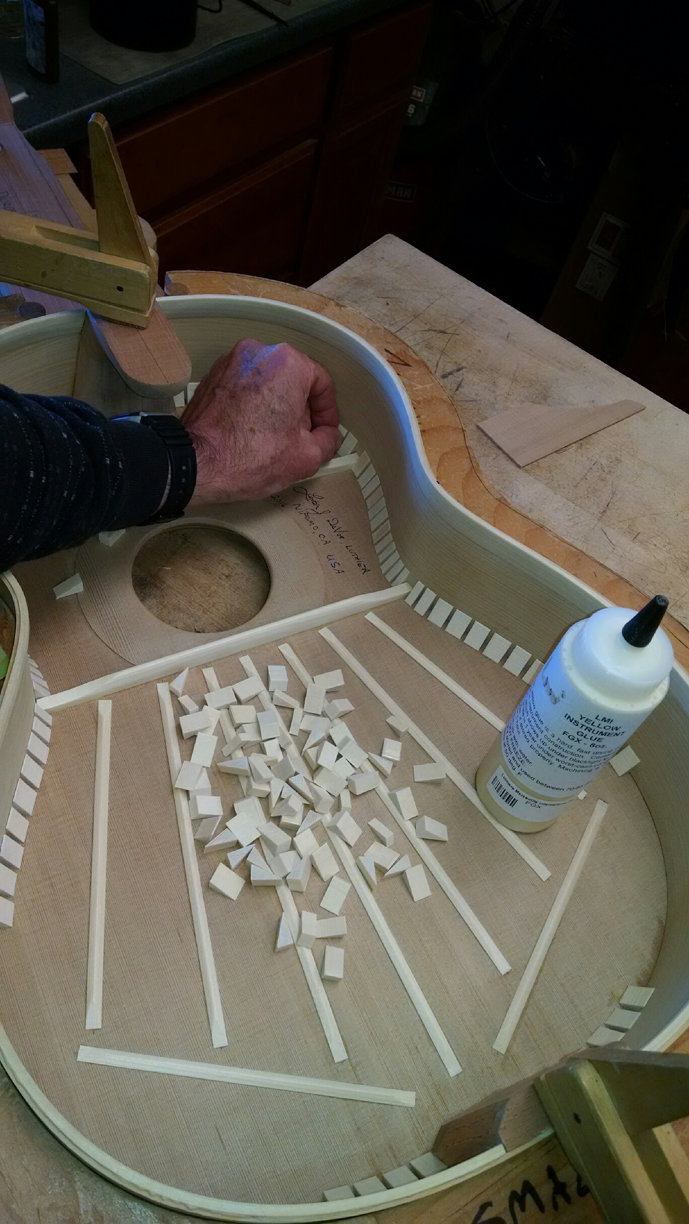 Glueing tentillones.  Each block is sanded to smooth and fit.