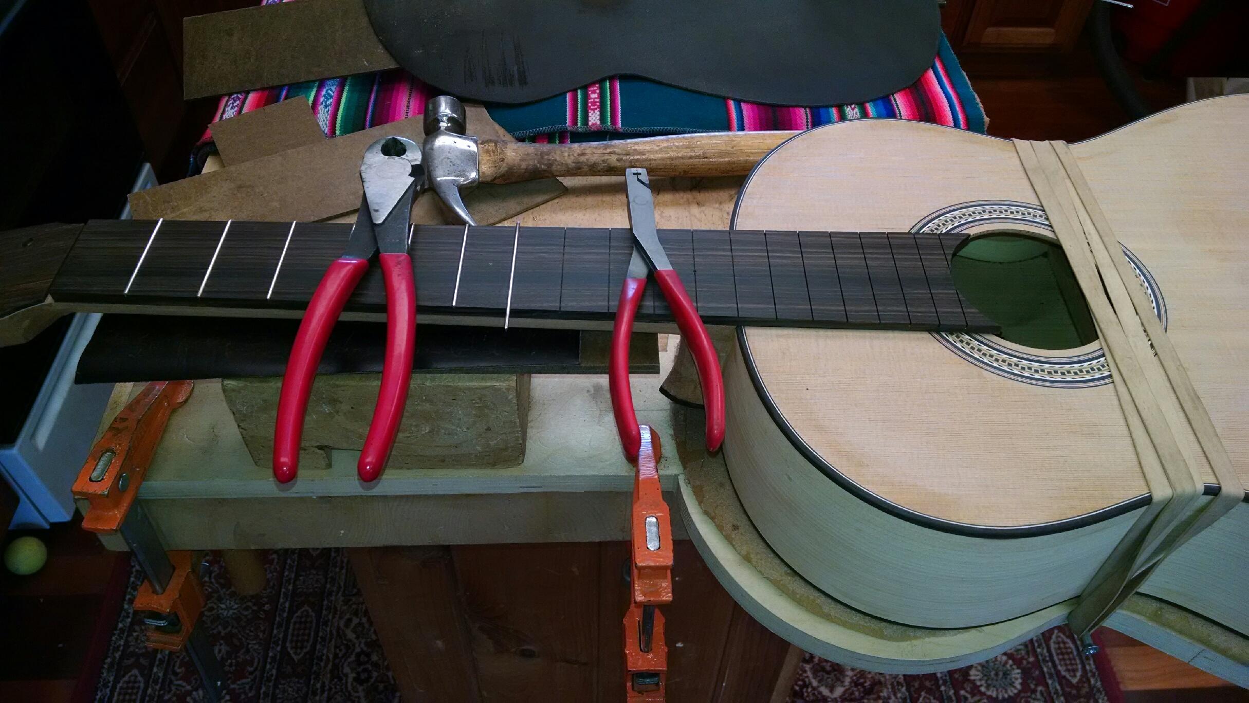 Fretting fingerboard.  Fretting tools.