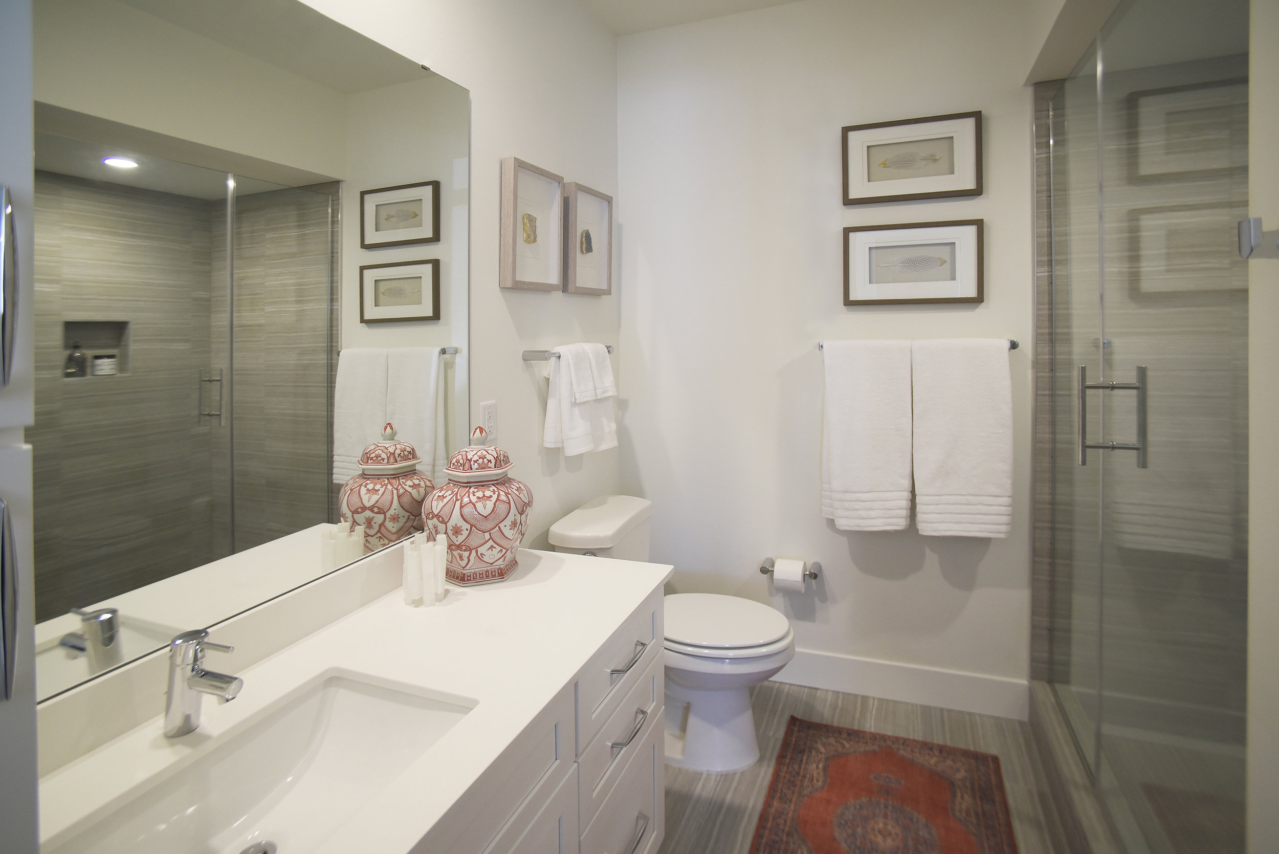 The bathrooms include heated floors. Each townhome features two full baths and a powder room.