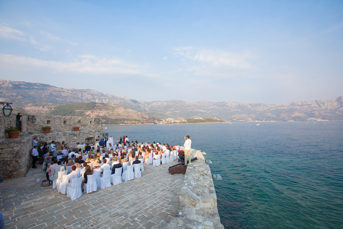 One of a set of images taken at Vanessa and Thor's destination Wedding in the beautiful Porto Montenegro.Stunning setting of the congregation at Budva Montenegro.Wedding Photography By Matt Porteous