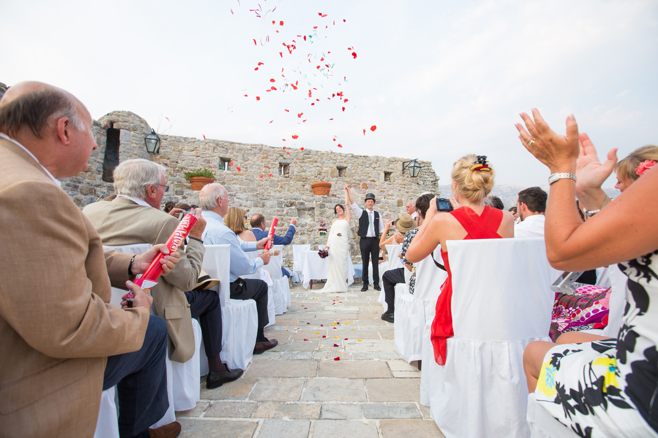 One of a set of images taken at Vanessa and Thor's destination Wedding in the beautiful Porto Montenegro. Bride and groom with confetti at Budva Montenegro.  Wedding Photography By Matt Porteous