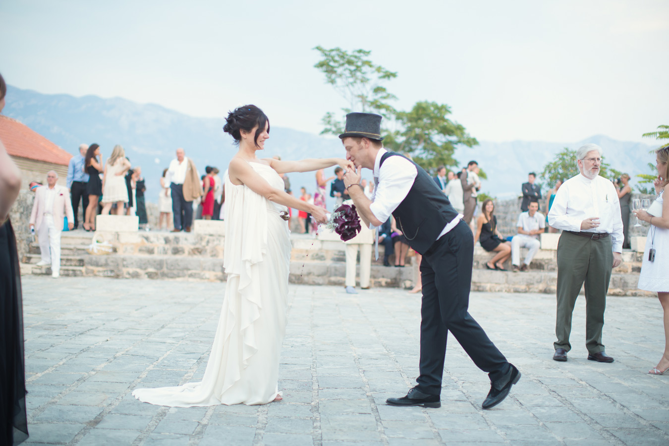 One of a set of images taken at Vanessa and Thor's destination Wedding in the beautiful Porto Montenegro. Groom kisses the bride's hand during their first dance. Wedding Photography By Matt Porteous