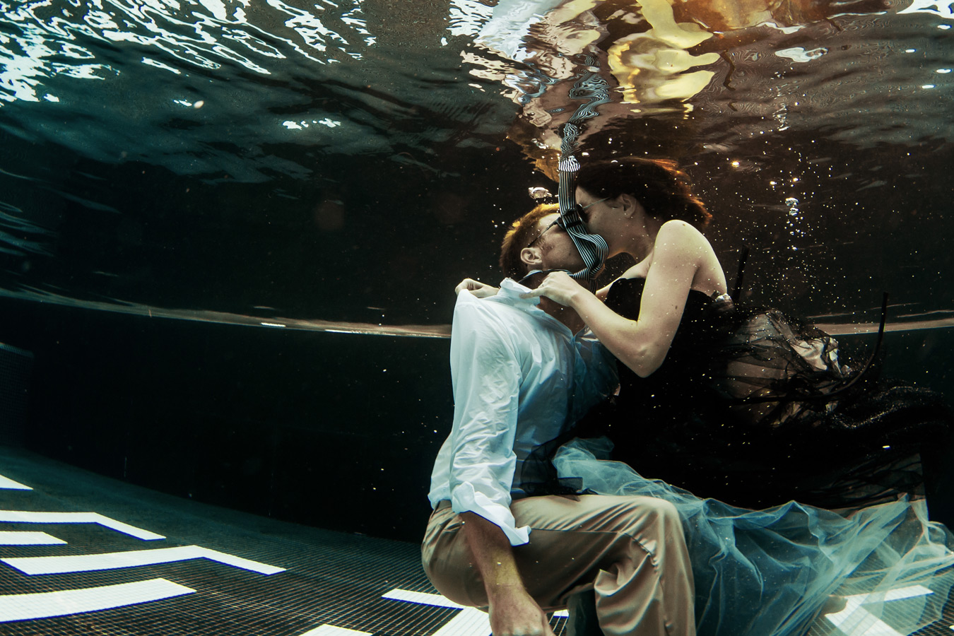 One of a set of images taken at Vanessa and Thor's destination Wedding in Porto Montenegro.Underwater kiss of the bride and groom at Montenegro Lido.Wedding Photography By Matt Porteous