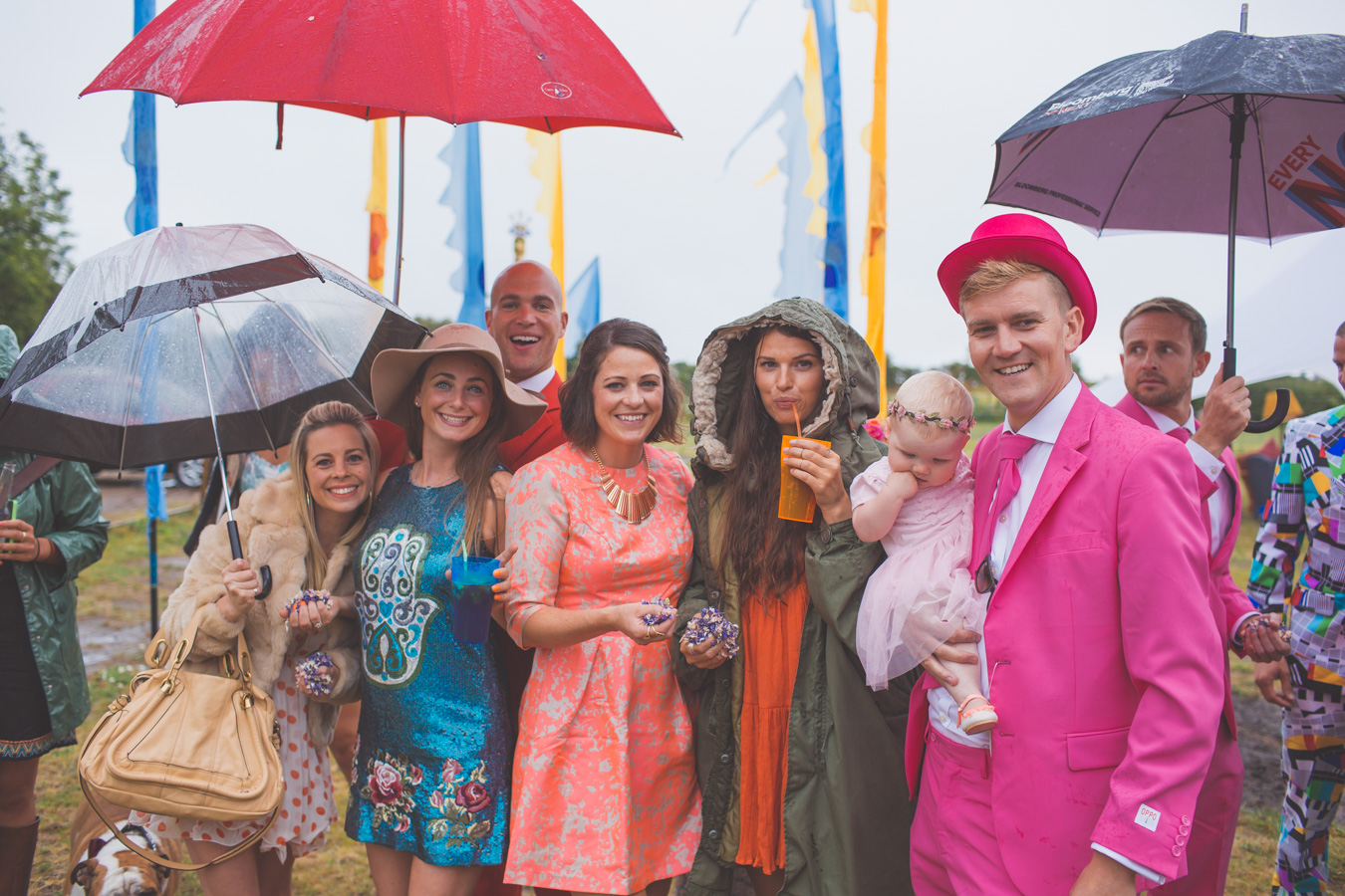 One of a set of images taken at this Destination Wedding of Jo and Steve, Jersey The Channel islands. Pink Opposuits and Fancy Dress, Festival style wedding.Photography By Matt Porteous & Max Burnett.
