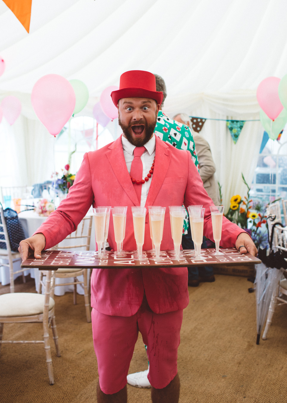 One of a set of images taken at this Destination Wedding of Jo and Steve, Jersey The Channel islands. Pink suit and champagne to celebrate. Wedding Photography By Matt Porteous & Max Burnett