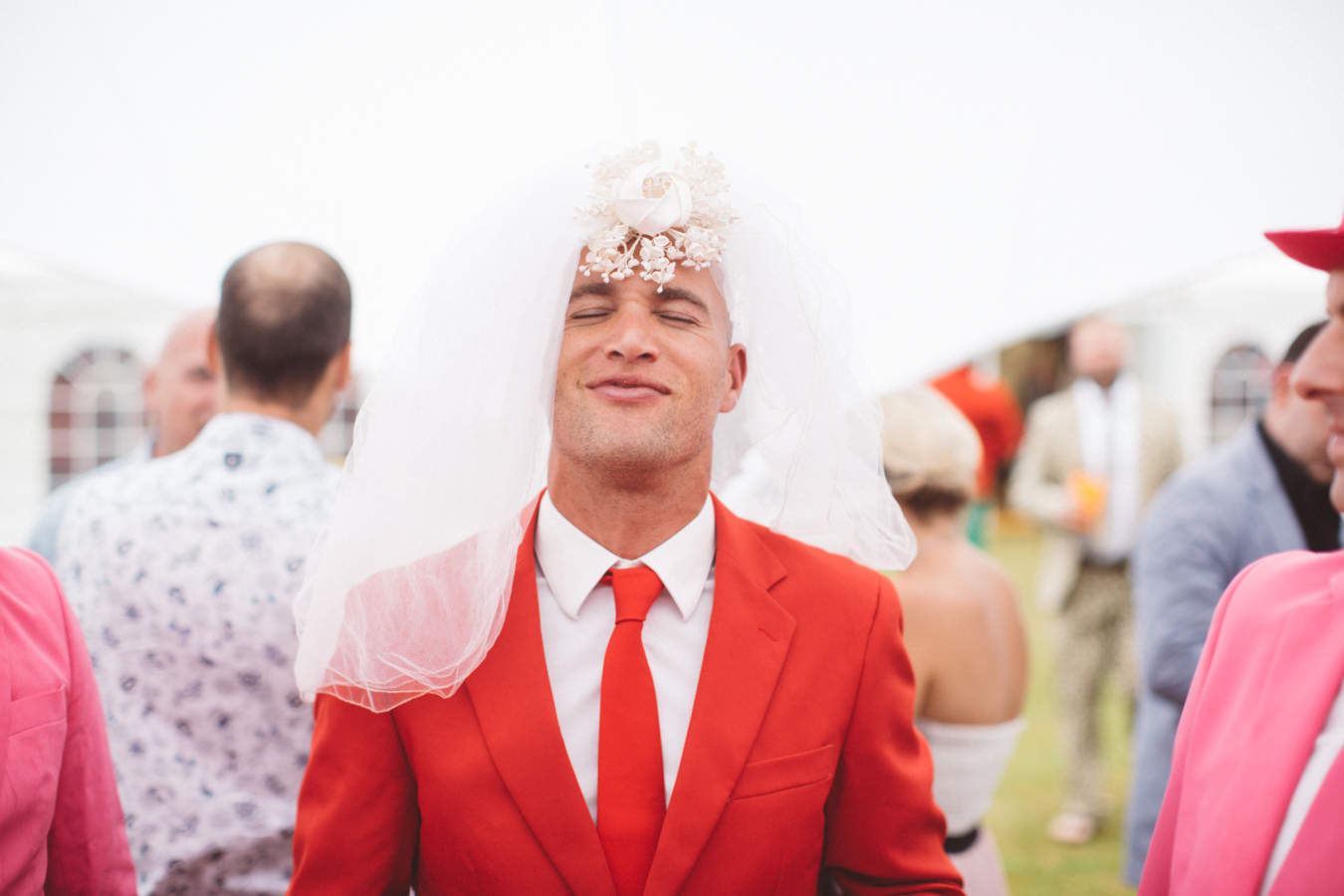 One of a set of images taken at this Destination Wedding of Jo and Steve, Jersey The Channel islands. Red Opposuit wears the brides veil. Wedding Photography By Matt Porteous & Max Burnett