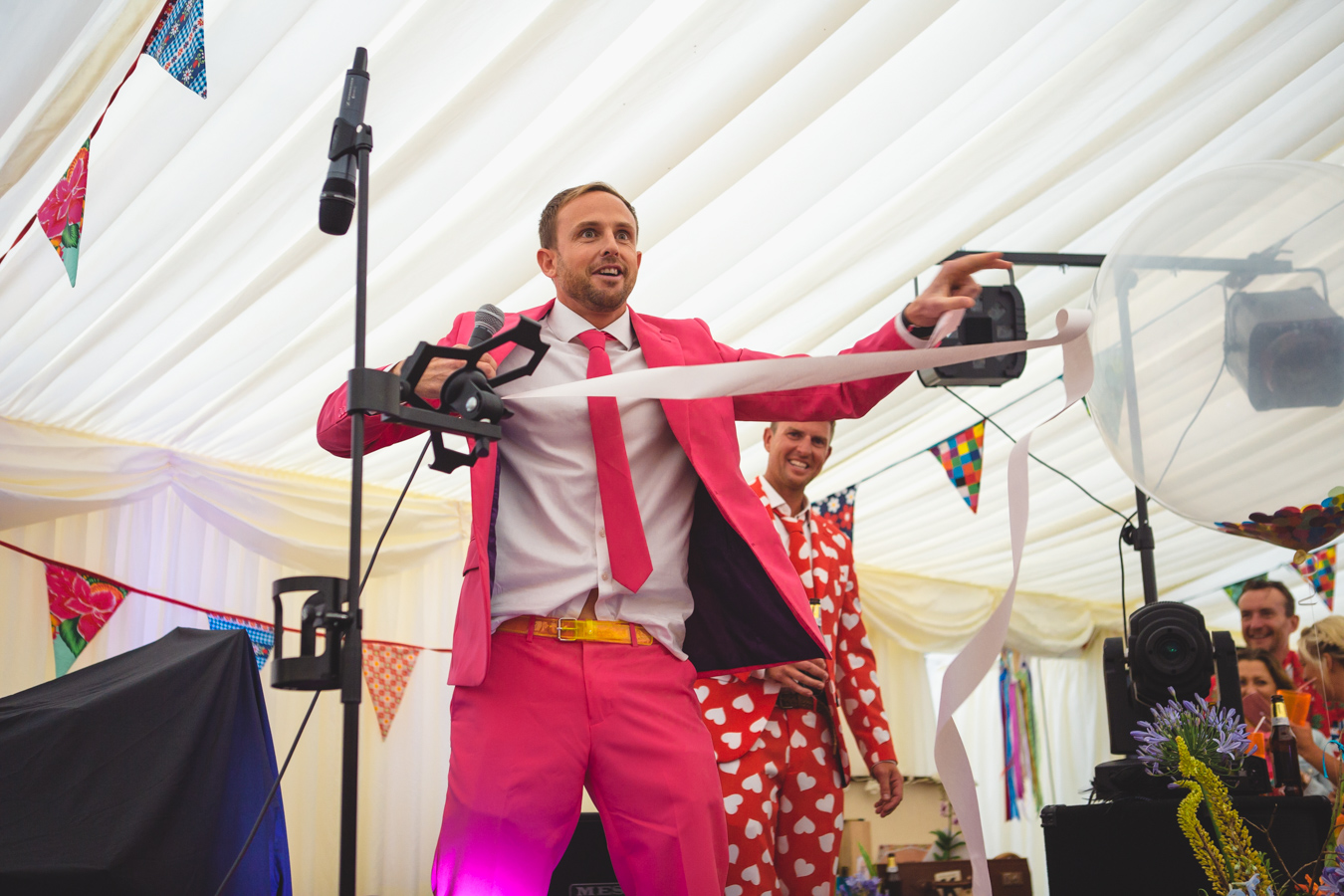 One of a set of images taken at this Destination Wedding of Jo and Steve, Jersey The Channel islands. Hilarious Best Man Speech dressed in pink Opposuit. Photography By Matt Porteous & Max Burnett.