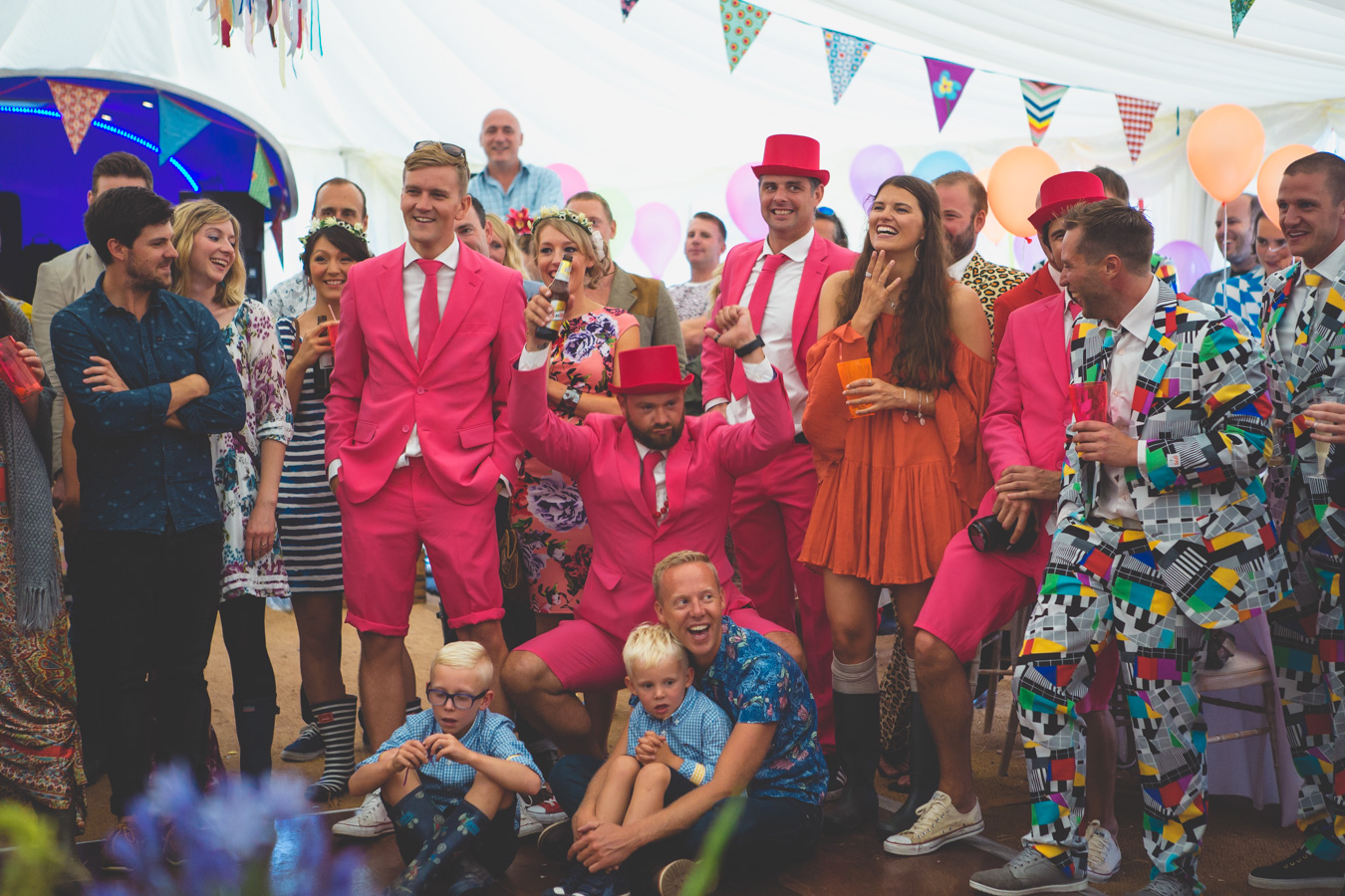One of a set of images taken at this Destination Wedding of Jo and Steve, Jersey The Channel islands. Ushers in their Opposuits during the best mans speech. Photography By Matt Porteous & Max Burnett.