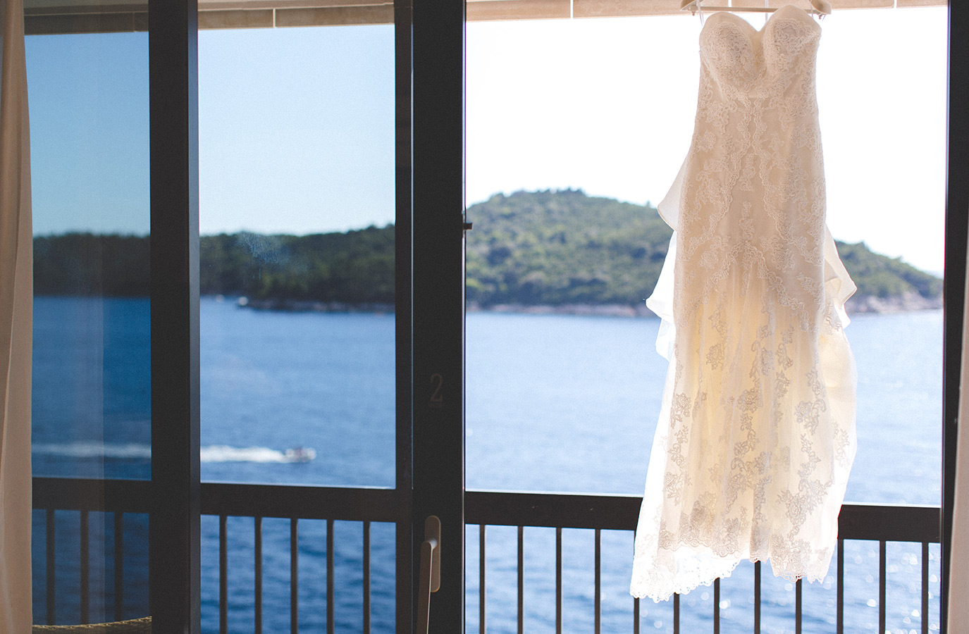 One of a set of images taken at this chic destination Wedding of Jenna & Nick. The stylish old town of Dubrovnik, Croatia.  The Wedding dress blows in the wind.  Photography by Matt Porteous