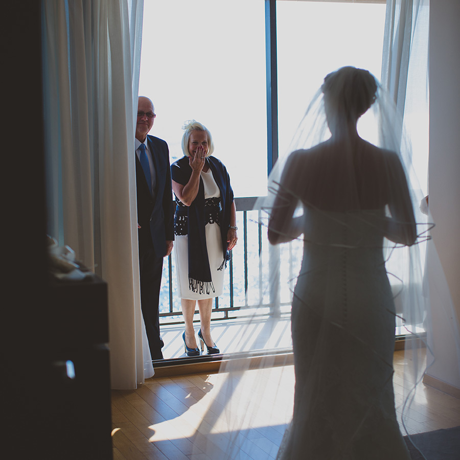 One of a set of images taken at this chic destination Wedding of Jenna & Nick. The stylish old town of Dubrovnik, Croatia.  Parents of the Bride look on proud.  Photography by Matt Porteous