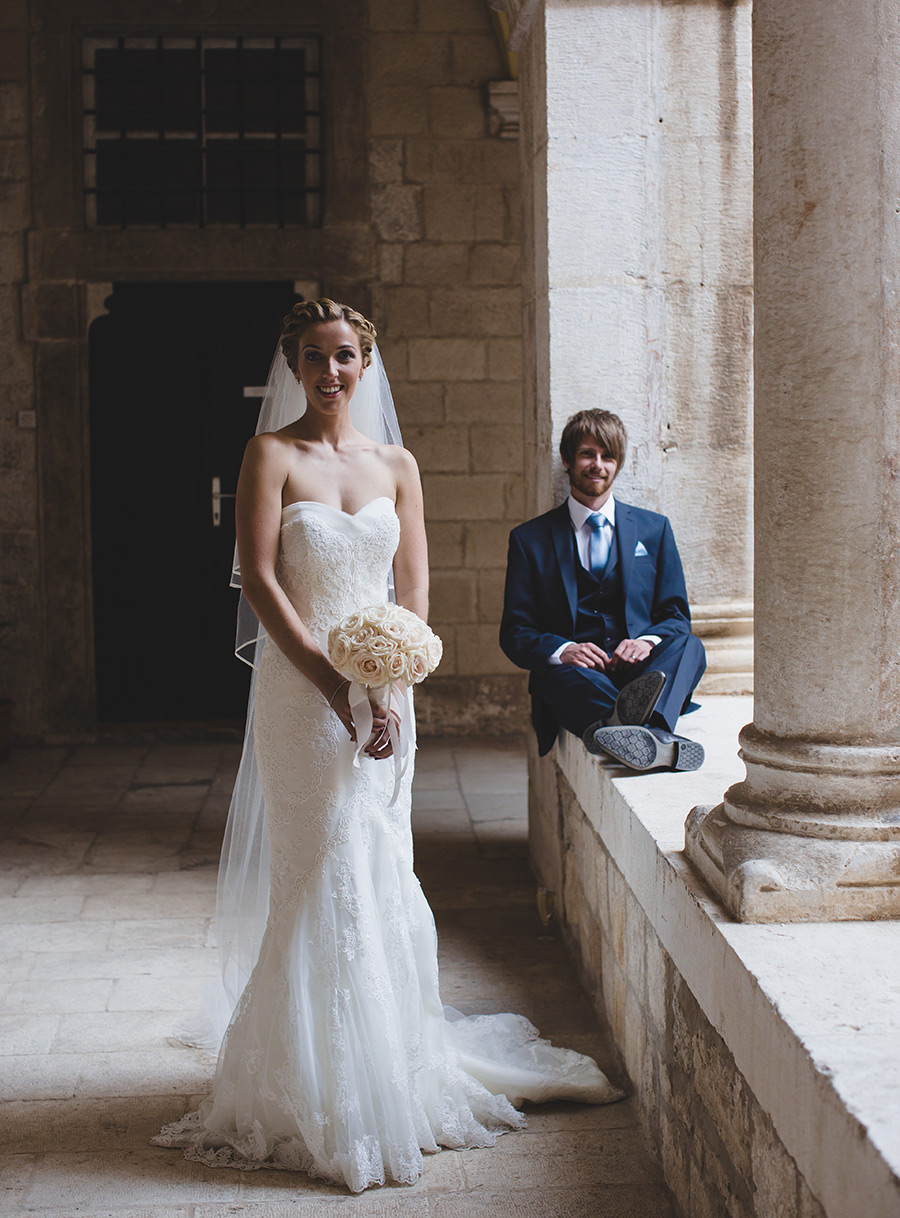 One of a set of images taken at this chic destination Wedding of Jenna & Nick. The stylish old town of Dubrovnik, Croatia.  The beautiful Bride poses in Ivory.  Photography by Matt Porteous