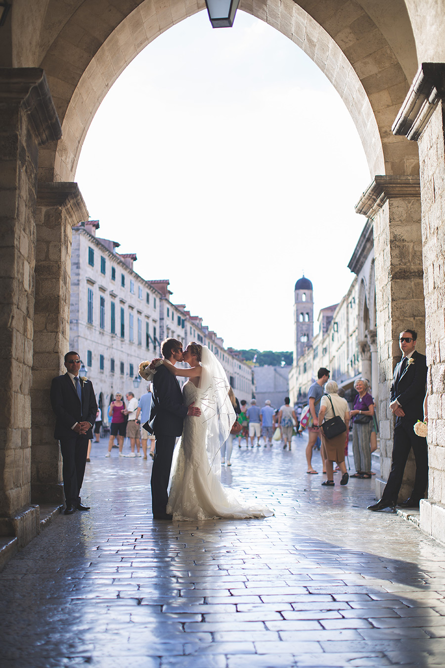 One of a set of images taken at this chic destination Wedding of Jenna & Nick. The stylish old town of Dubrovnik, Croatia.  The couple share a kiss.  Photography by Matt Porteous